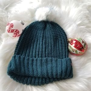 Blue hat with white pompom